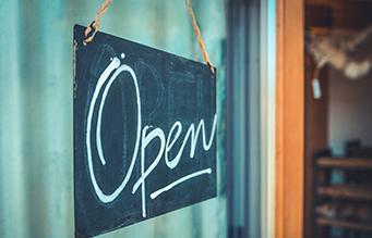 image of small business open sign with high-speed satellite Internet