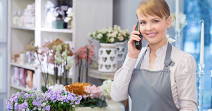 Woman on phone in flower shop